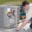 Air Conditioning Repairman checking Freon levels...
