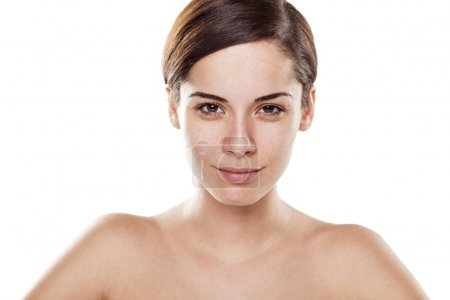 Photo pour Young woman without make-up and naked shoulders on white background - image libre de droit