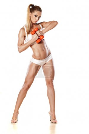 Muscular woman with weights