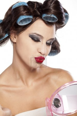 Hair curlers and bad make up