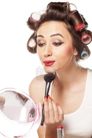Housewife applying blush