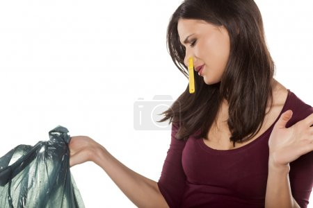 Woman holding garbage