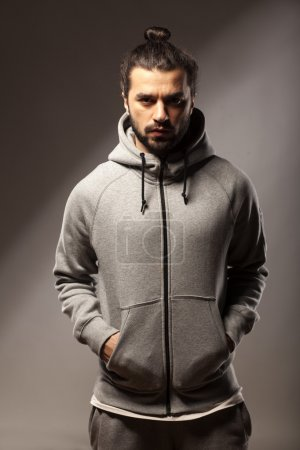 Photo for Young man with beard and a bun in tracksuits - Royalty Free Image