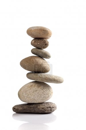 Photo for Balanced stack of different river stones on white background - Royalty Free Image