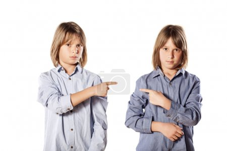 Photo for Two twins brothers pointing finger at each other - Royalty Free Image