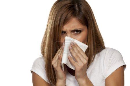 beautiful woman sneezing