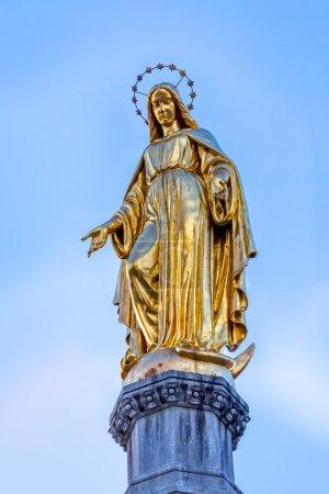 Virgin Mary golden statue