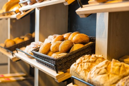 Photo for Bread and buns in baskets on shelf in bakery or baker's shop - Royalty Free Image