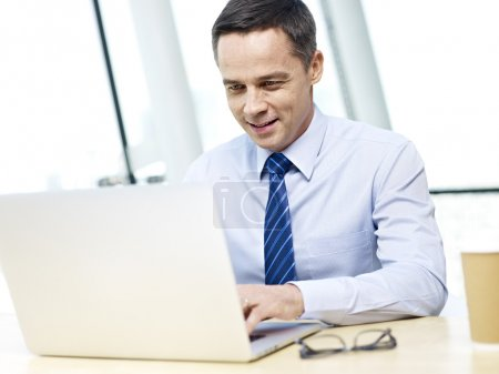 business executive working in office with laptop