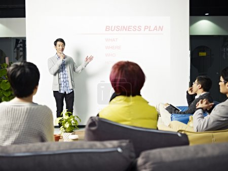 young asian man presenting business plan