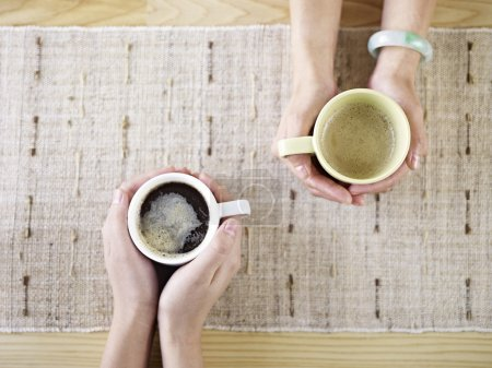 Photo for Two people talking while drinking coffee. - Royalty Free Image