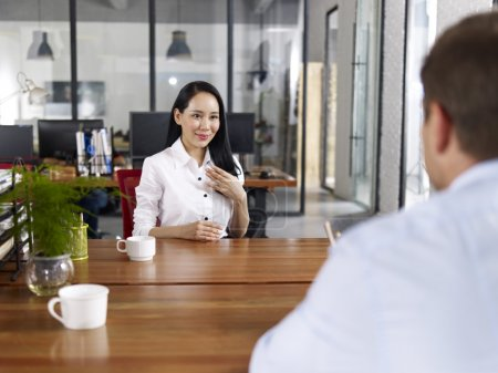 young asian business executive being interviewed