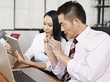asian business people working together