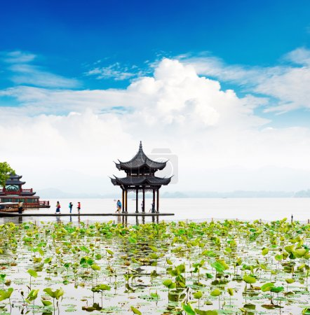Ancient pavilion on lake in hangzhou
