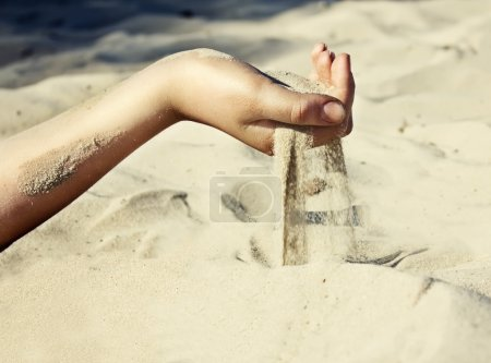 Sand is pouring through his fingers