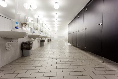 Mens restroom in an public building in white and b...