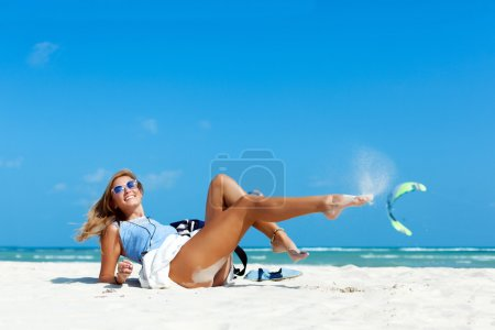 woman with sexy tanned legs on the beach