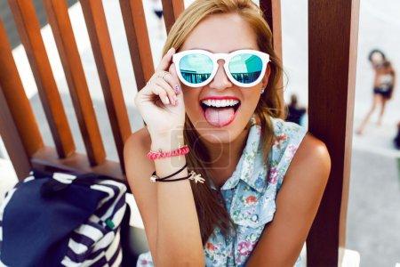 girl showing tongue and having fun