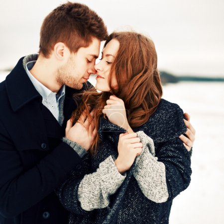 young  couple in love in winter