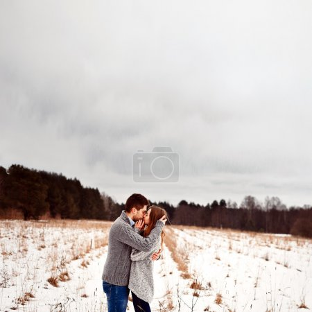 Boy and girl kissing in winter