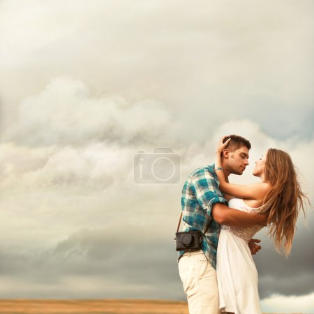 Sensual couple posing outdoor in spring