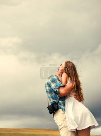 sensual couple posing outdoor in spring