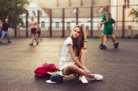 girl with skateboard and backpack. Hipster lifestyle