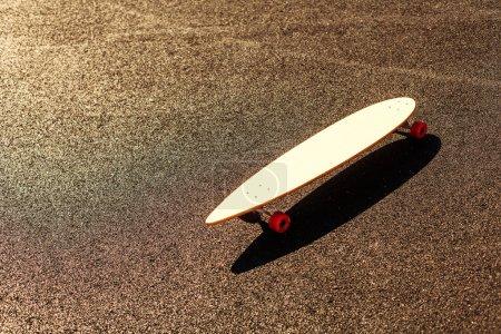 Longboard on asphalt road
