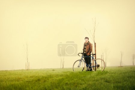 Young man  with vintage bike