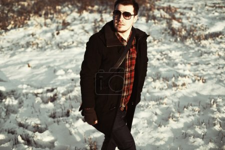 young handsome man posing outdoor