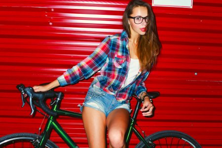 young girl posing with sport bicycle