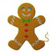 Gingerbread man of knitted fabric isolated on white background