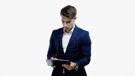 Confident businessman writing on clipboard isolated on white