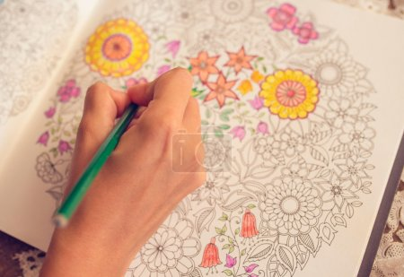 Photo for Paint Coloring Book and woman hand - Royalty Free Image