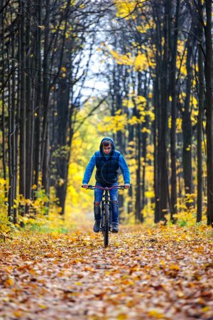 Cyclist autumn forest