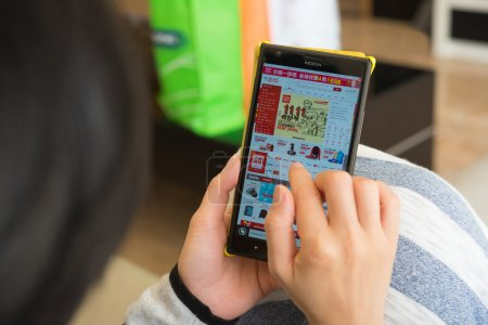 young woman shopping through mobile on jd on Chinese online shopping day