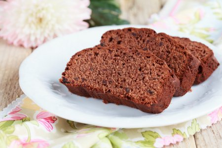 Slices of homemade chocolate cake with figs and a cup of coffee