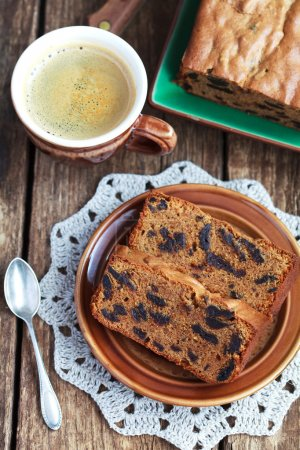 Cake with prunes and almond flour on a wooden table, selective focus