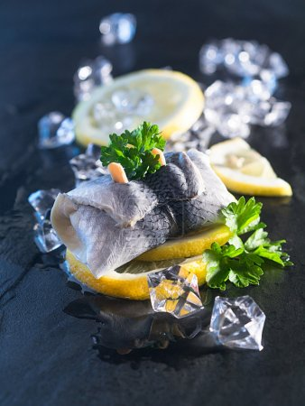Rollmop herring on lemon slices
