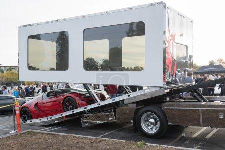 Bugatti Veyron entering enclosed auto