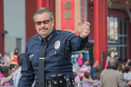 Photo for Los Angeles, California, USA - February 21, 2015 - Charlie Beck, chief of the Los Angeles Police Department at 116th Annual Golden Dragon Parade, celebrating the year of the ram in Chinatown Los Angeles. - Royalty Free Image