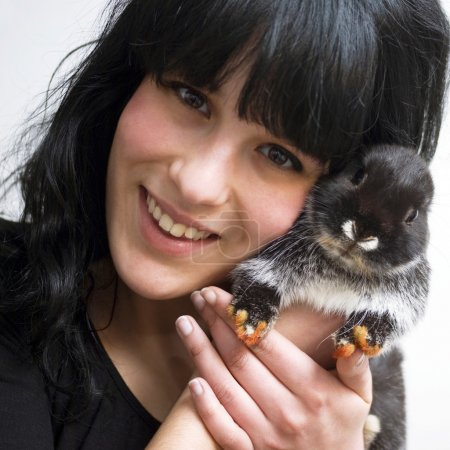 Smiling girl with rabbit