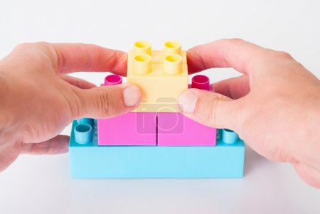 Photo for Building of children's blocks with hands - Royalty Free Image
