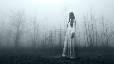 Haunted female ghost in the spooky forest