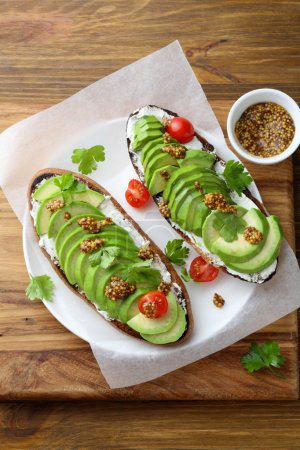 Fresh avocado toasts for breakfast