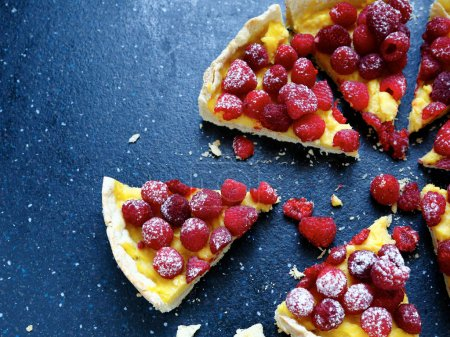 raspberry tart on a dark background