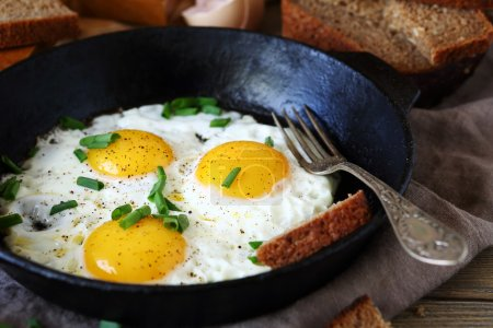 Photo for Hot fried eggs in a pan, close up - Royalty Free Image