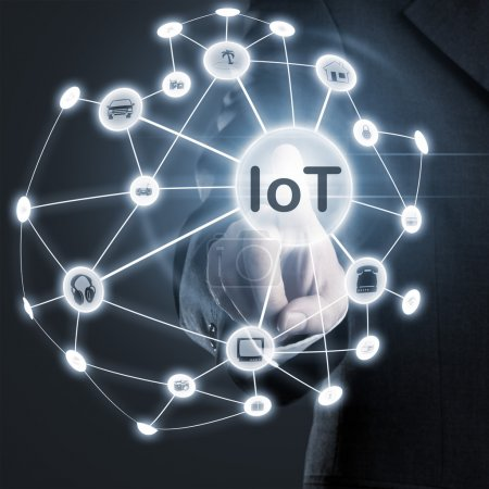 Photo for Man touching IoT (internet of things) network on display - Royalty Free Image