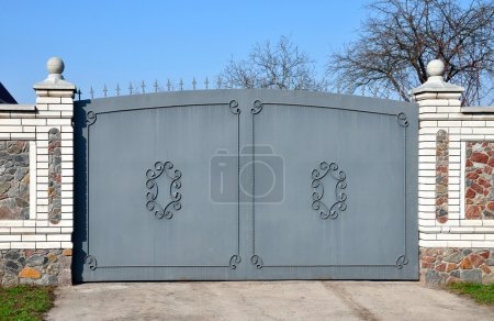 Photo for Stone fence with iron gate - Royalty Free Image