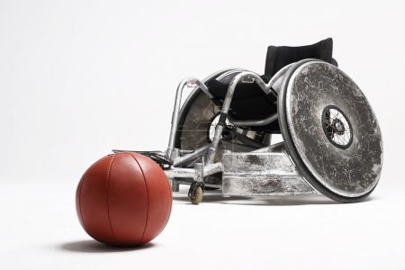 Wheelchair and medicine ball...